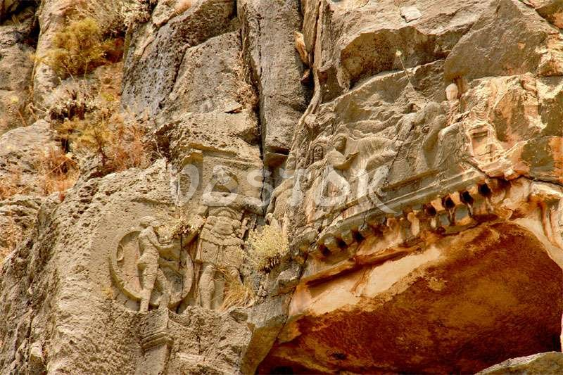 Low relief on ancient Lycian rock tombs in Myra Turkey