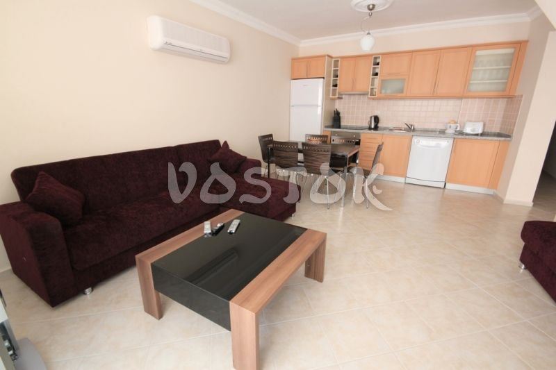 Open plan kitchen - living room - Sunset Poseidon Apartments in Calis Fethiye