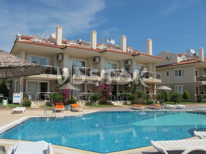 View of apartment's building from the pool side - Sunset Aqua Apartments in Calis Turkey
