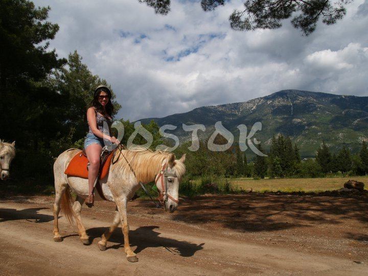 Get in touch with nature during Kayakoy horse riding