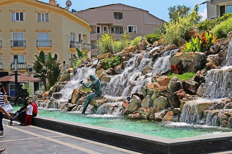 Waterfall and statue of mermaid in the center of Marmaris