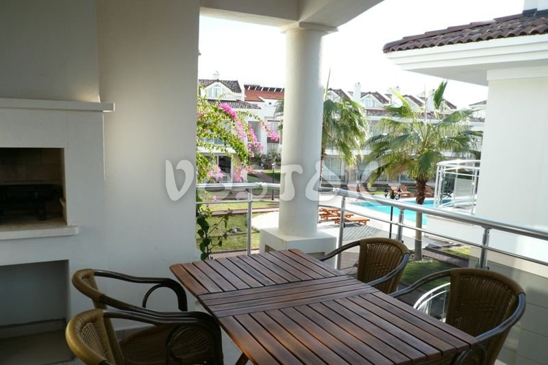 Large terrace with wooden table and chairs - Blue Green Apartments Calis Beach