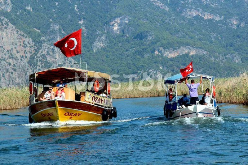 Boats are heading to Dalyan Turtle Beach - Dalyan Mud Bath Tour
