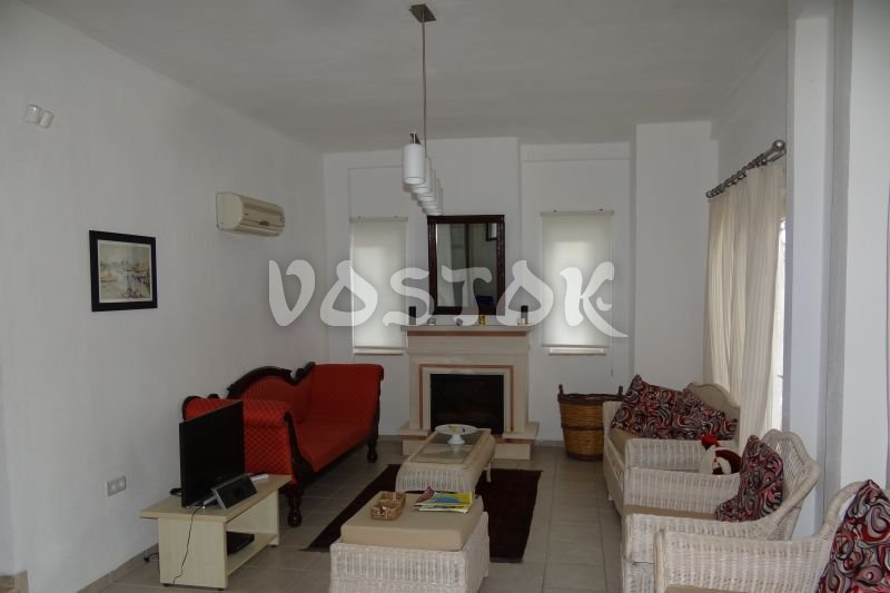 Living room with fireplace - Santi Villa in Uzumlu