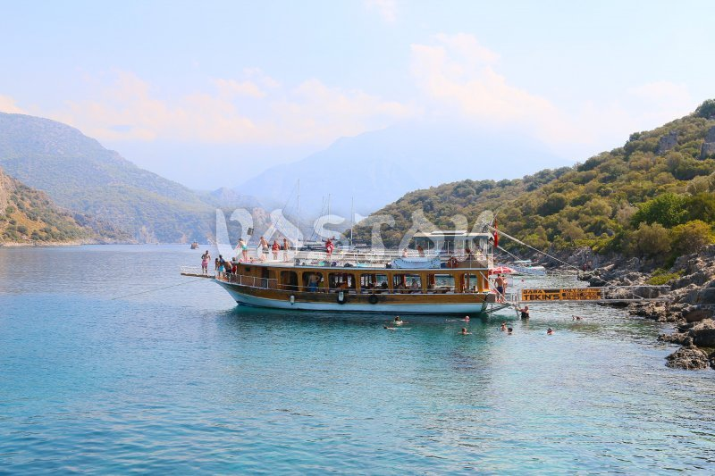 Regular double decker boat is anchored at Saint Nicholas Island - Oludeniz Boat Trips
