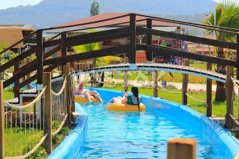 Wooden bridge over The Lazy River - Fethiye water park
