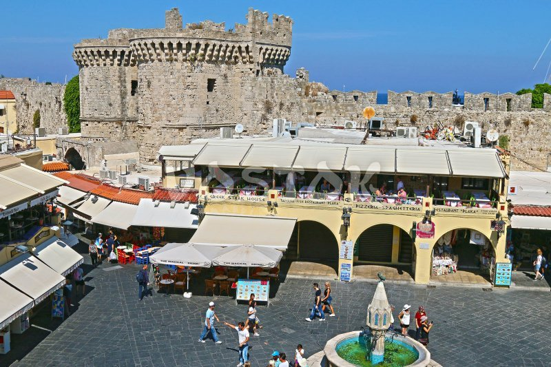 Main square of Rhodes town with many shops and restaurants