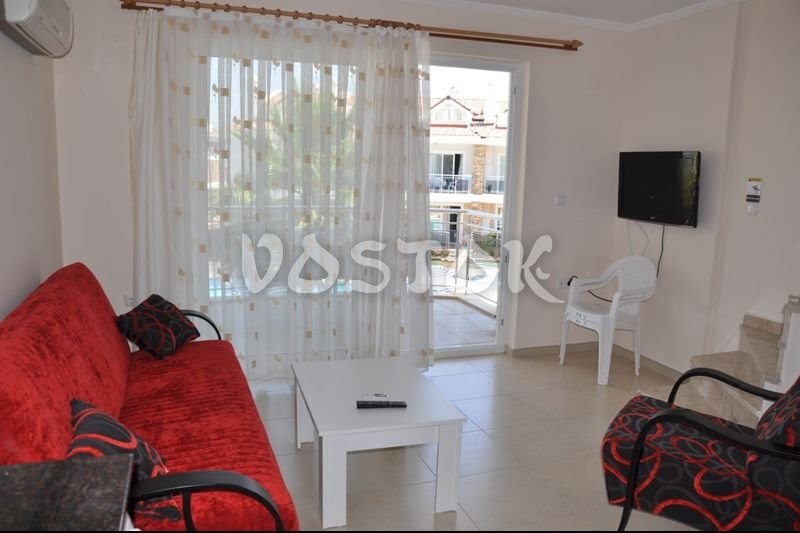 Living room with flat TV - Blue Green apartments Fethiye