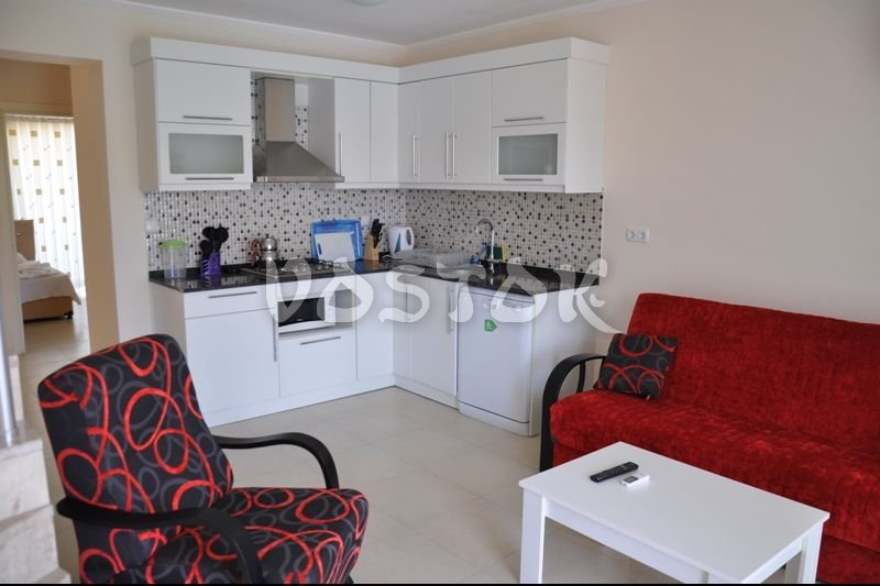 Open plan kitchen - dining room - Blue Green apartments Fethiye