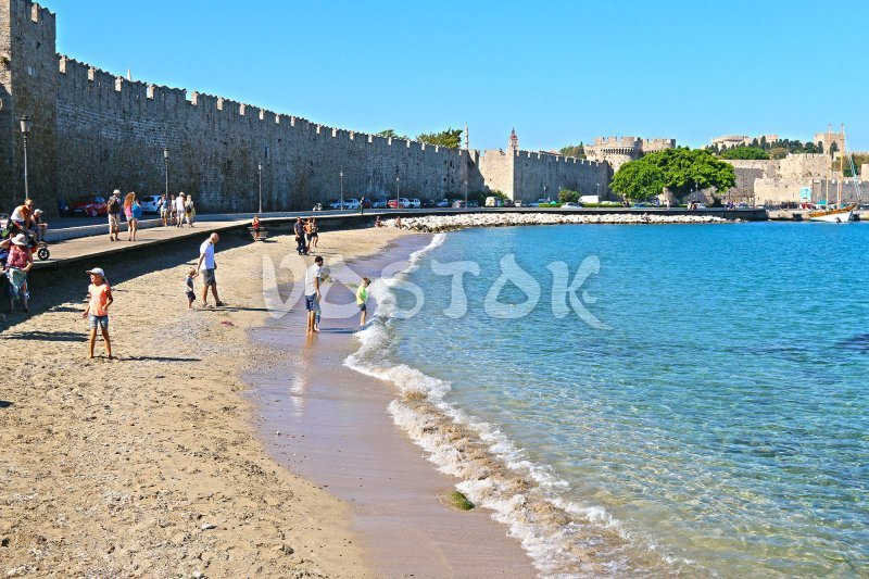 The water is crystal clear despite the fact that it is Rhodes harbor