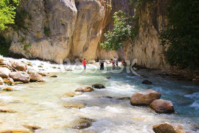 Cross-over the river with cold and fast water - Saklikent Canyon