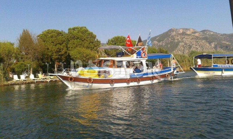 Naughty 69 boat is available for private boat hire in Dalyan including crab fishing and swimming with turtles.
