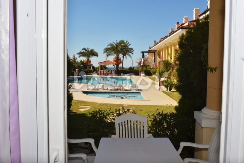 View to shared pool - Seaside Villa in Calis Beach