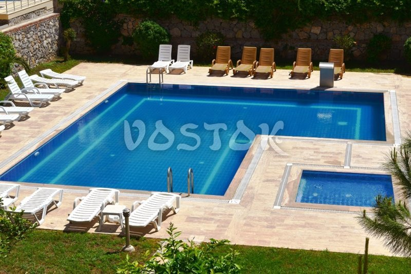Shared swimming pool - Saros Apartments in Calis Fethiye