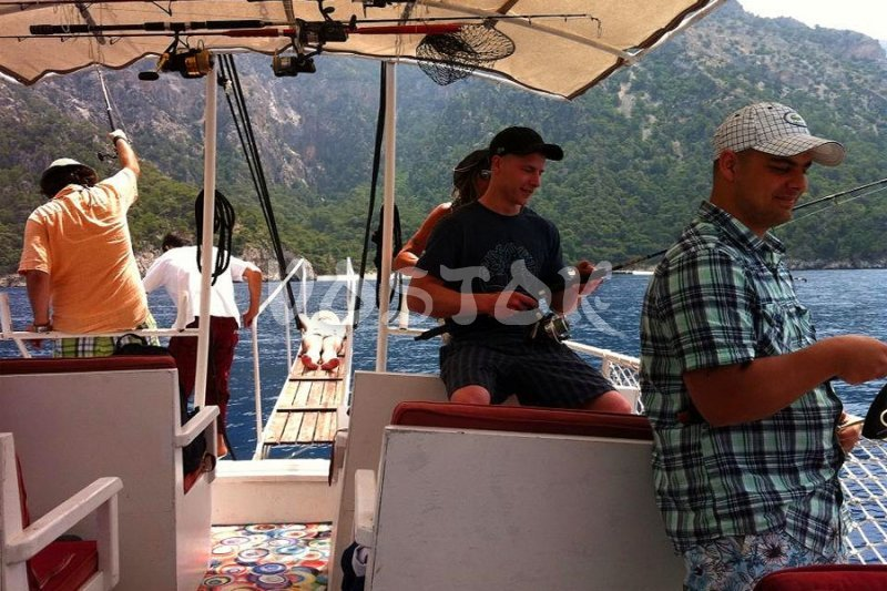 Some people are fishing when others are sunbathing - Fishing in Oludeniz Turkey