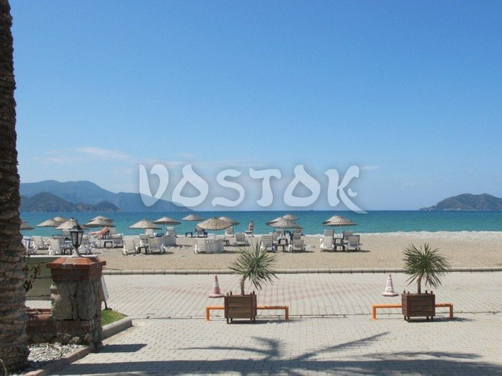 View to the beach from complex main entrance - Sunset Aqua Apartments in Calis Turkey