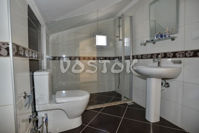 Shower with a glass made wall on attic floor - Talia Villa in Calis Fethiye