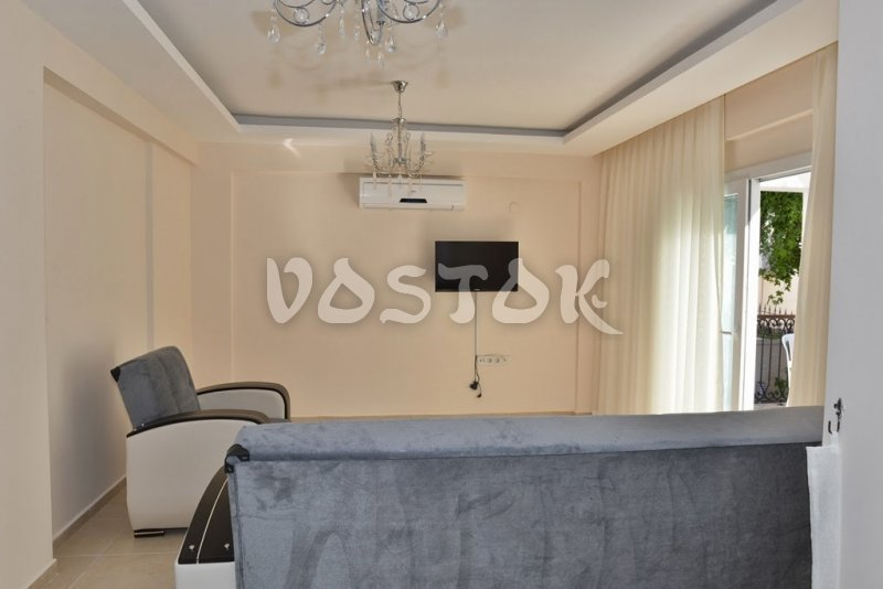 Living room with flat TV - Talia Villa in Calis Fethiye