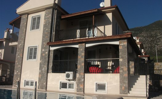 <p>The 3 floors fully airconditioned Oriana villa in Ovacik with nice mountain views. It consists of 2 double bedrooms with en-suite bathrooms, 2 twin rooms, 1 single room and 2 further bathrooms. The Villa Oriana G is suitable for up to 9 people.</p>