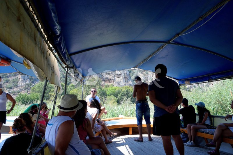 Guide is telling about ancient Lycian tombs of Kaunos on the way from Dalyan to Iztuzu beach (Dalyan Turtle Beach)