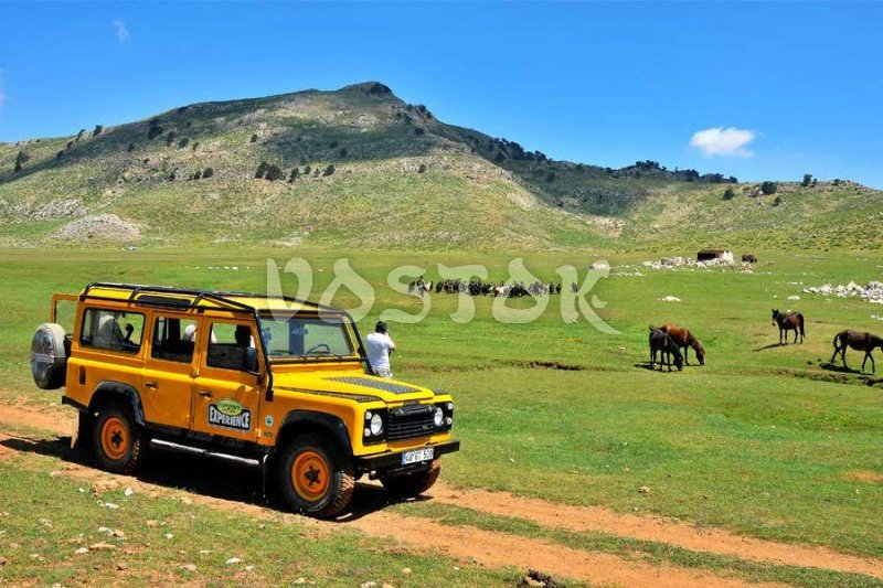 Almost wild nature, mountains and yellow Land Rover Defender - perfect picture